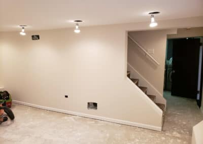 painted-wall-baseboards-staircase