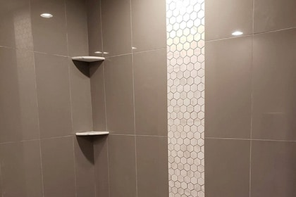 white mosaic shower-tiles in Prospect Heights