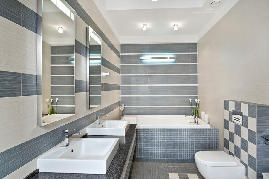 modern bathroom with two sinks and blue white tiles