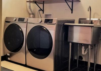 renovated-modern-bathroom-with-a-washing-machine